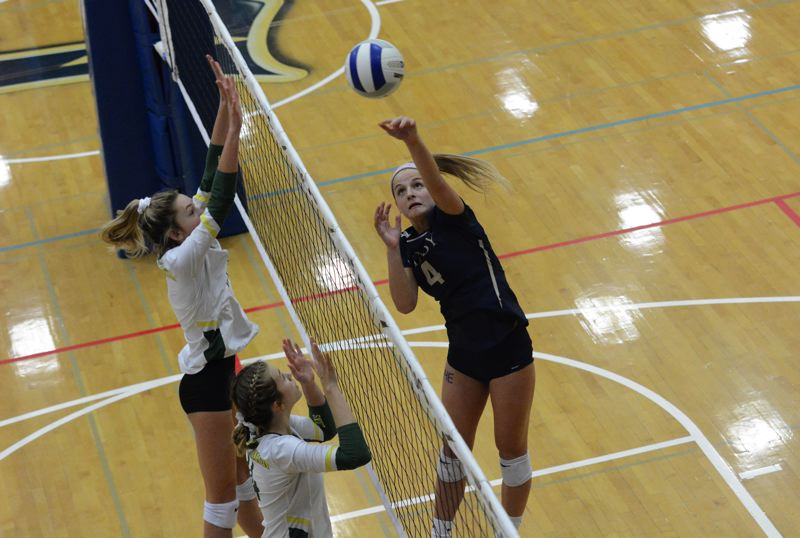 PMG PHOTO: DEREK WILEY - Ruby Kayser hits the ball over the net Saturday afternoon against West Linn.