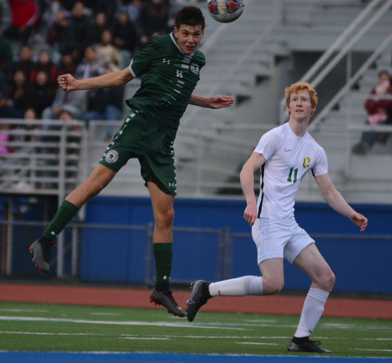 PMG PHOTO: DAVID BALL - Reynolds Rogelio Uribe Gonzalez sends a header toward the goal during the second half of Saturdays 6-4 loss to Cleveland in the 6A quarterfinals.