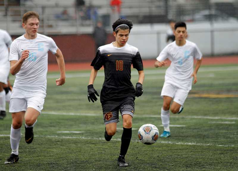 PMG PHOTO: WADE EVANSON - Forest Grove freshman forward Kevin Miranda dribbles up the field during the Vikings' state quarterfinal against Centennial Saturday, Nov. 9, at Forest Grove High School.