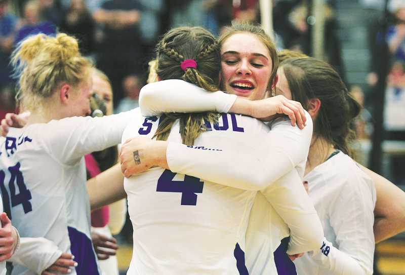 INDEPENDENT PHOTO: PHIL HAWKINS - Senior Erin Counts (right) embraces freshman Annabelle Davidson following the team's state championship victory. Counts is one of four seniors on this year's team, joined by Isabelle Wyss, Destiny Smith and Karlee Southerland.