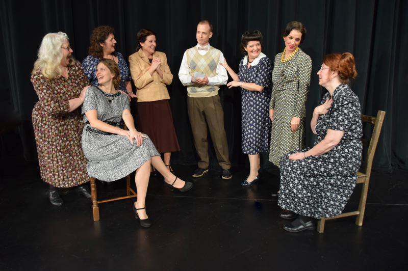 PHOTO BY KARMIN TOMLINSON - The cast of 'Octette Bridge Club' includes, from left to right, Ann Haldy, Terri Schafer (sitting), Arleen Daugherty, Wendy May, Stephen Rickard, Vicki Guthrie, Karie House and Diane Borcyckowski. Not pictured is Daria DeLillo.