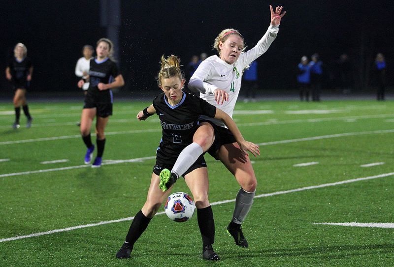 PMG PHOTO: MILES VANCE - West Linn's Abby Schmidt (right) clashes with Mountainside's Ellie Smith during the Lions' 2-0 loss in the Class 6A state quarterfinals at Mountainside High School on Saturday, Nov. 9.