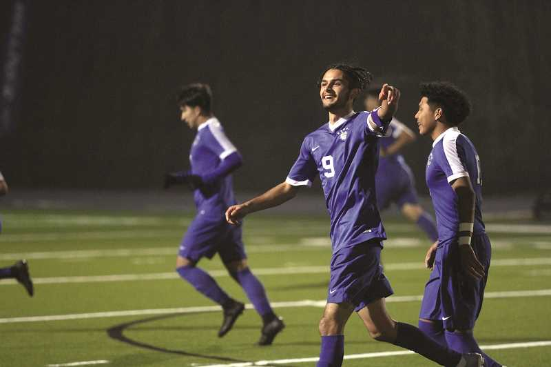 PMG PHOTO: PHIL HAWKINS - The Woodburn Bulldogs breathed a sigh of relief after senior Rodolfo Campuzano tied the game in the 67th minute in the first round against the North Valley Knights last week.