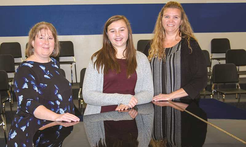 RAMONA MCCALLISTER - From left: Sue Green, choir director for CCMS and CCHS, Avery Chamness and Tanya Chamness, Avery's mother.