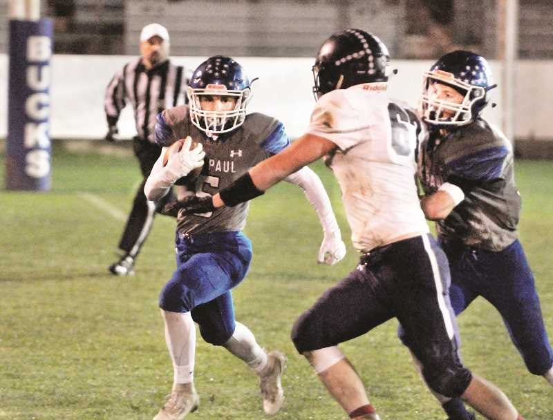 PMG PHOTO: GARY ALLEN - St. Paul senior Gianni Grasso led the top-ranked Buckaroos with three touchdowns in a 58-6 win over No. 16 Elgin in the first round of the 1A state playoffs on Friday.