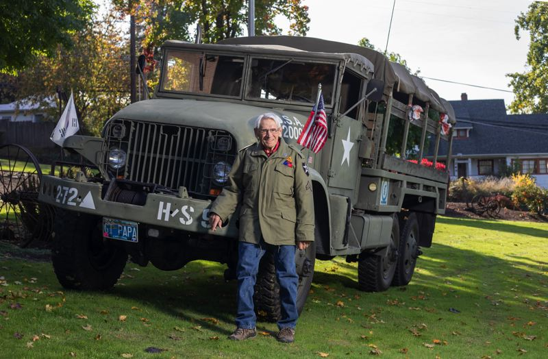 PMG PHOTO: JONATHAN HOUSE - Leonard Bernhardt, a Korean War vet, shows off a replica of his Army truck during the war.