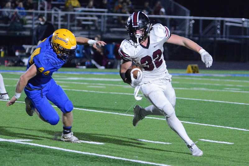 PMG PHOTO: DAVID BALL - Glencoe running back Royce Fasel runs around end during the Crimson Tide's first round playoff game against Barlow Friday, Nov. 8, at Barlow High School.