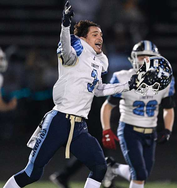 PMG PHOTO: CHRISTOPHER OERTELL - Liberty's Cole Lovejoy celebrates the Falcons' come-from-behind win over Grant Friday night, Nov. 8, at Marshall High School.