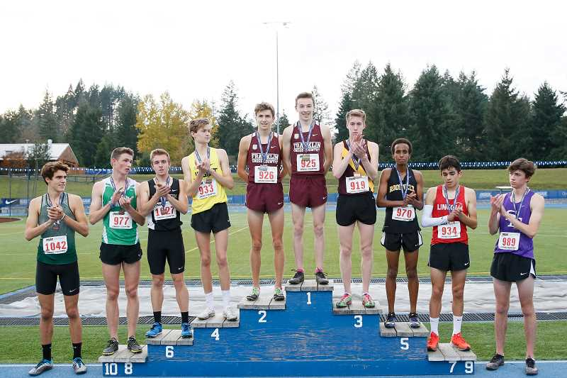 PMG PHOTO: SOOBUM IM - Forest Grove's Quincy Norman (919) stands at the podium to receive his third place medal at last weekend's OSAA State Cross Country Championships, held Nov. 9 at Lane Community College in Eugene.