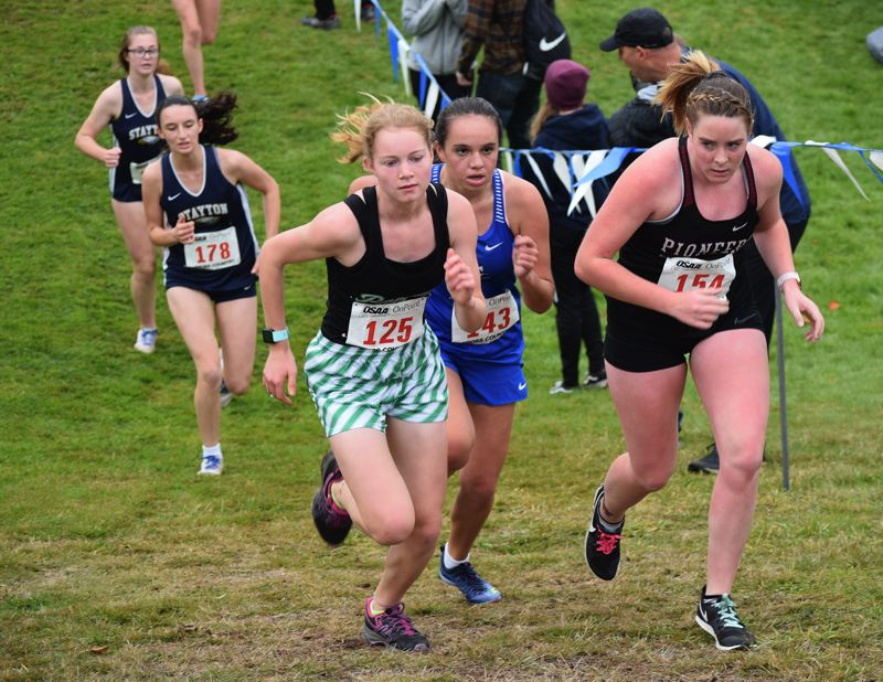 CONTRIBUTED PHOTO: JOSIAH SHAVER - Estacada rookie Heather Shaver climbs a hill on the state course on her way to a team-best 37th-place finish Saturday.