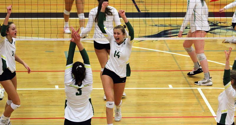 PMG PHOTO: MILES VANCE - West Linn's Rayna Reynolds (No. 14) leads her team in cheers during its 3-1 win over Sheldon in the quarterfinals of the Class 6A state tournament on Friday, Nov. 8, at Liberty High School.