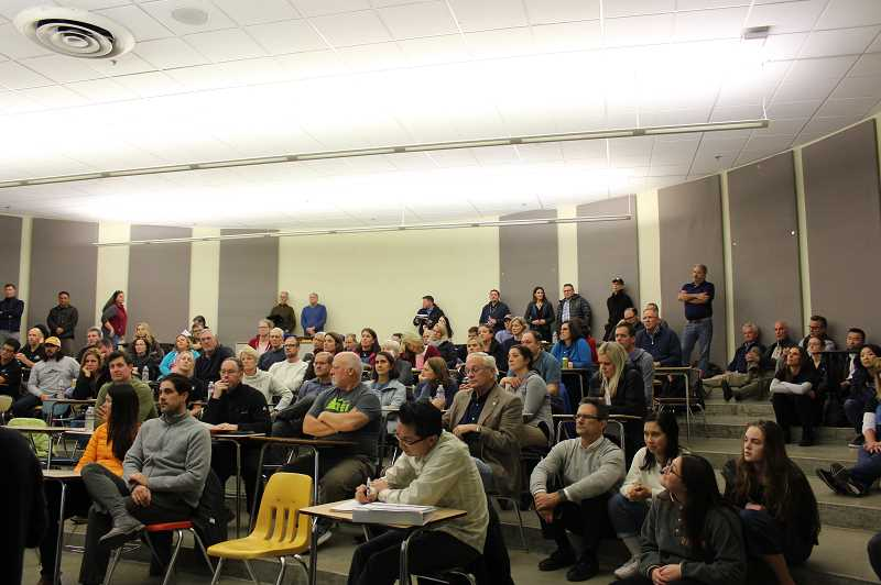PMG PHOTO: ASIA ALVAREZ ZELLER - A packed crowd in Lakeridge High Schools Rotunda Room receives pool updates.