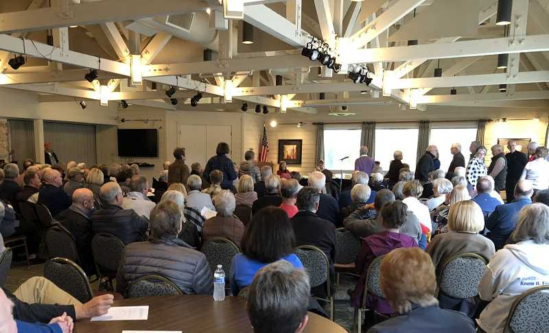 PMG PHOTO: COREY BUCHANAN - Residents filed into Charbonneau Country Club last Tuesday to hear arguments for or against putting key decisions up for a vote by homeowners.