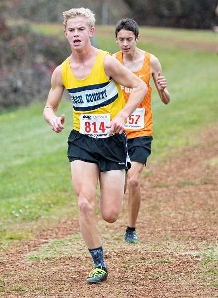 LON AUSTIN/CENTRAL OREGONIAN - Alec Carne nears the track at the end of Saturday's state cross country meet. Carne finished in 18th place overall with a personal record time of 16:19.8 as the Cowboys placed sixth as a team.