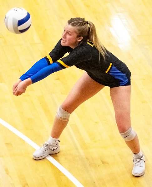 LON AUSTIN/CENTRAL OREGONIAN - Kacie Stafford plays a ball against La Salle Prep on Saturday. Stafford led the Cowgirls with 82 digs in the tournament.