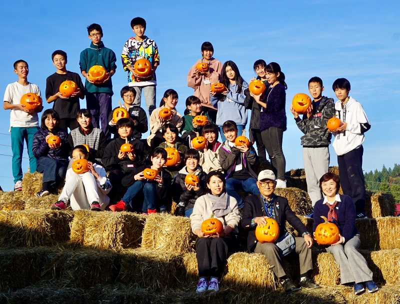 COURTESY PHOTO  - The delegation of students from Kitakata, Japan, carved pumpkins at Frog Pond Farm during the trip.
