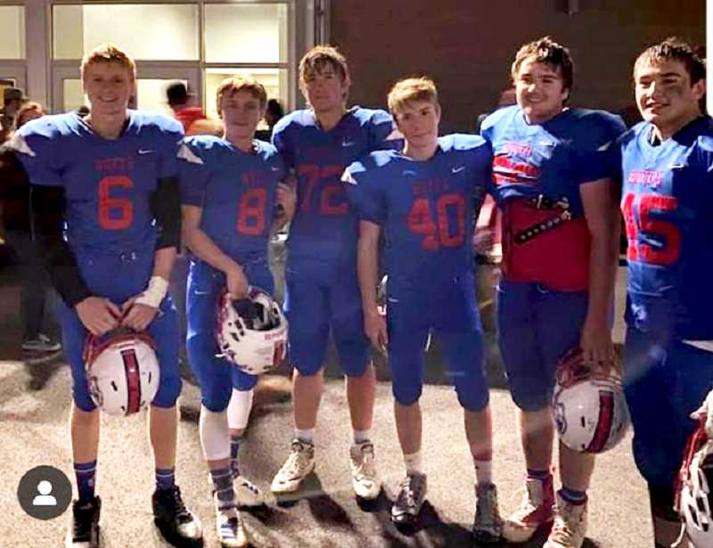 SUBMITTED PHOTO - Left to right, Bryce Simmons, Nathan Stout, Seth Colton, Tom Kallenbach, Jacob Hulsey, and Kody Zemke pose for a group picture on their senior night football game.