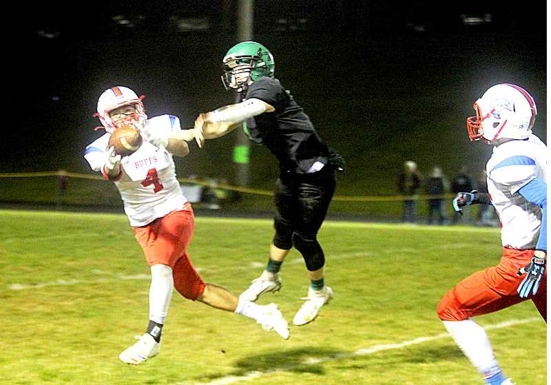 JAYSON SMITH - Keenan Miller scores on a 40-yard catch during Madras' 40-7 first round state playoff loss to Rainier Nov. 8.Madras finished the year with a 6-4 overall record.