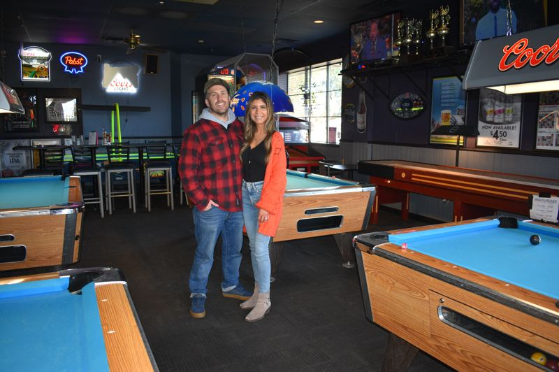 PMG PHOTO: SHANNON O. WELLS - Jake and Ashlee Whitney are pleased with their latest purchase, the popular Skyland Pub at 3175 S. Troutdale Road.