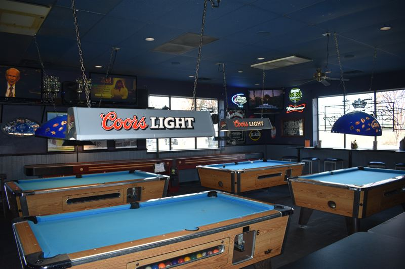 PMG PHOTO: SHANNON O. WELLS - Skyland offers six pool tables, including these vintage style as well as two tournament style, along with amusements like shuffleboard, video games and video lottery.