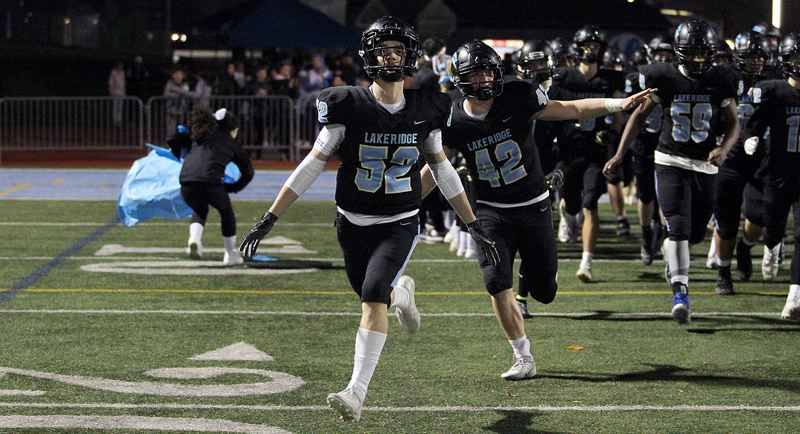 PMG PHOTO: MILES VANCE - Lakeridge's Ronin Murphy (No. 52) and Ty Glumbik (No. 42) - shown here before playing Lake Oswego - led the Pacers' defense in its 48-27 win over Beaverton on Friday, Nov. 8.