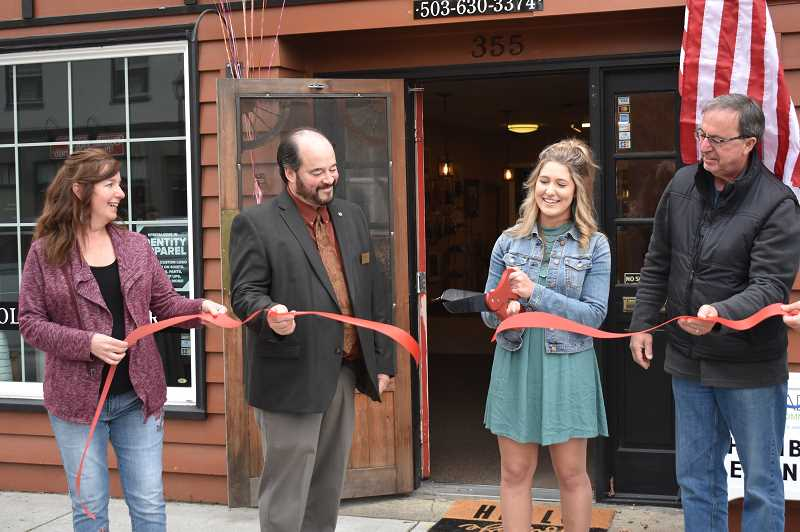 PMG PHOTO: EMILY LINDSTRAND - Emalee Long cuts the ribbon during the grand openng of Blush & Roses Flower Shop last weekend.