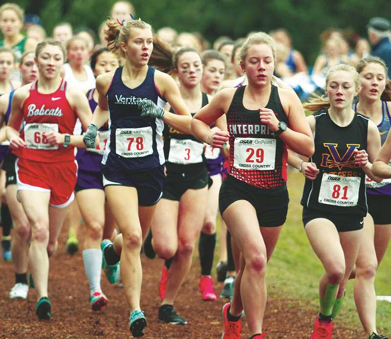 INDEPENDENT PHOTO: PHIL HAWKINS - Veritas sophomore Breanna Schmidt (No. 78) placed 13th in a personal record time of 20:06 at the 2A/1A cross-country state championships Saturday at Lane Community College in Eugene.