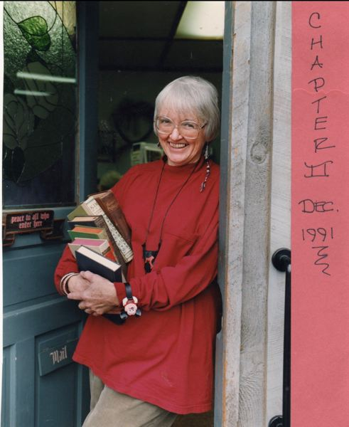 COURTESY PHOTO: MELODY HAVELUCK - Pat Yoakum poses for a photo in the doorway of her bookstore on 21st Avenue in Forest Grove.