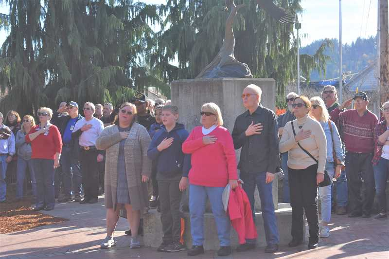 PMG PHOTO: EMILY LINDSTRAND - Attendees of the Estacada Veterans Day Ceremony take a moment for the Pledge of Allegiance.