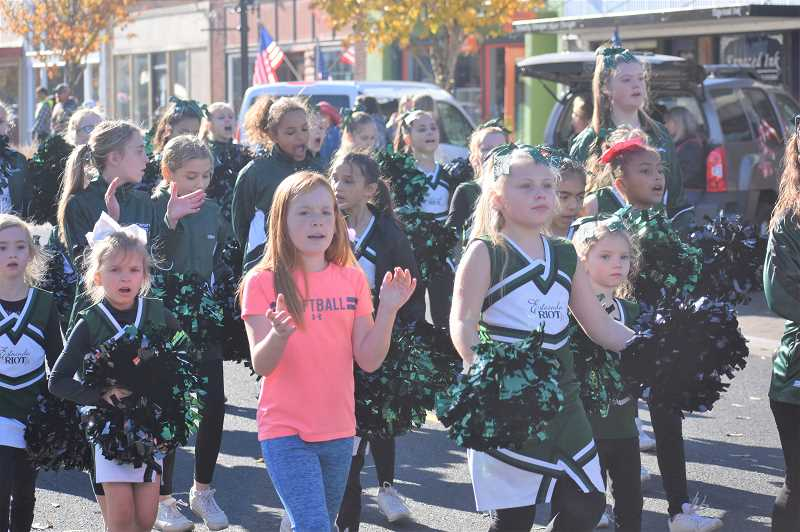 PMG PHOTO: EMILY LINDSTRAND - Members of the Estacada Junior RIOT Dance Team cheered their way through the annual Veterans Day parade.