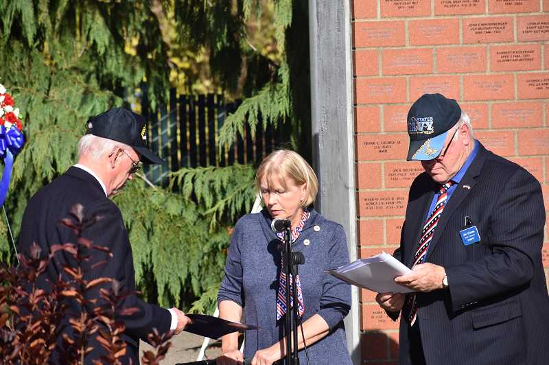 PMG PHOTO: EMILY LINDSTRAND - Members of the Estacada Area Support Our Troops Foundation read the newest names on the memorial bricks.