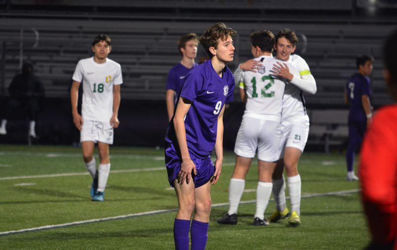 TIMES PHOTO: MATT SINGLEDECKER - Sunset senior Julian Thuillier and the Apollo boys soccer team was upended in the Class 6A second round.