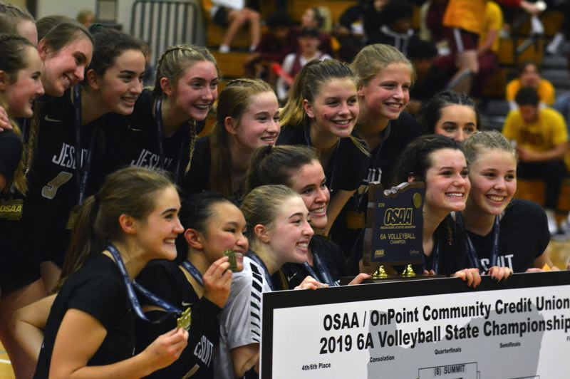 TIMES PHOTO: MATT SINGLEDECKER - The Jesuit volleyball team knocked off Central Catholic to take its second straight Class 6A state title game.