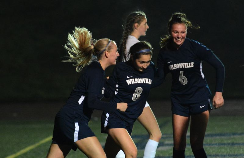 PMG PHOTO: DEREK WILEY - Renee Lee, Haley Stahl and Keira McNamee celebrate during the second half of Wilsonville's 6-1 victory over Churchill.