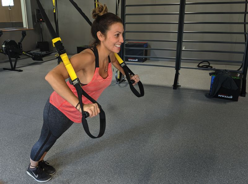 PMG PHOTO: BRITTANY ALLEN - Trainer Alesia Soll says the new Base Camp program is to help customers be successful in their fitness goals.