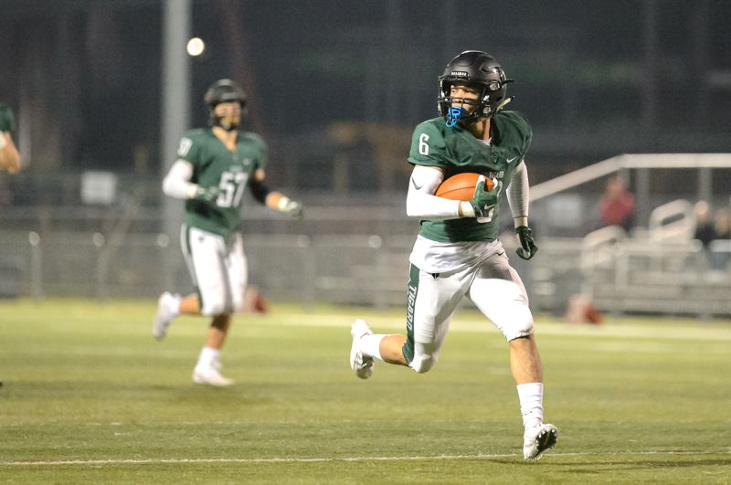 COURTESY PHOTO: CHRISTOPHER GERMANO - Tigard High School senior Max Lenzy heads to the end zone for one of his two first-quarter touchdowns in the Tigers' 56-20 playoff win over Century.