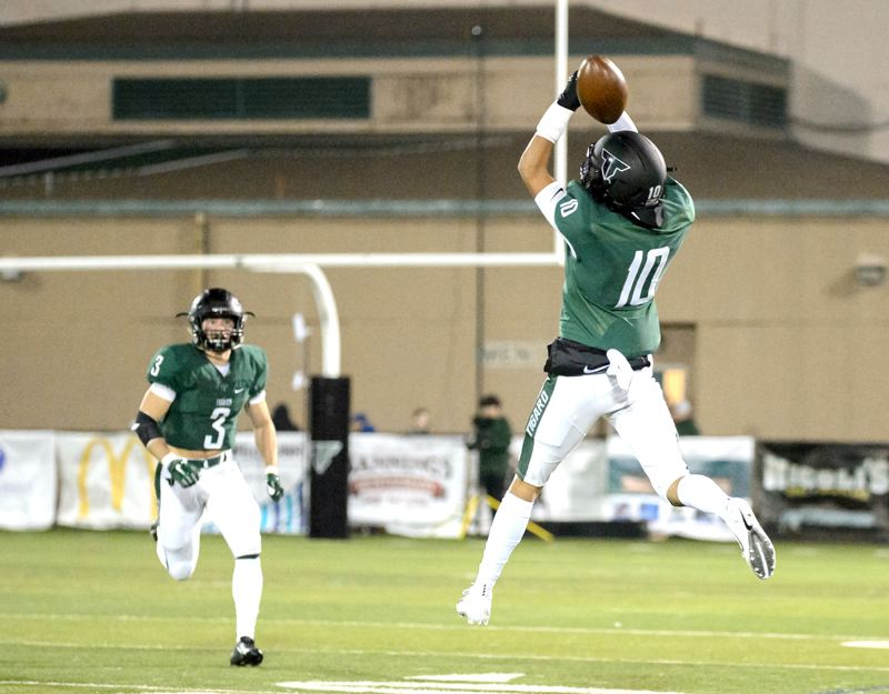 COURTESY PHOTO: CHRISTOPHER GERMANO - Tigard High School sophomore Keenan Speer-Johnson (10) goes up high for the ball during the Tigers' playoff game with Century. Speer-Johnson had a fumble recovery in the 56-20 win.