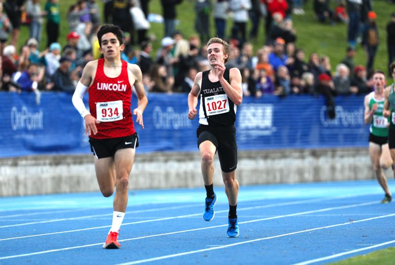 PMG PHOTO: SOOBUM IM - Tualatin High School senior Andrew Payton (1027) sprints to the finish line to take sixth place in the boys race at the Class 6A state track and field championships.