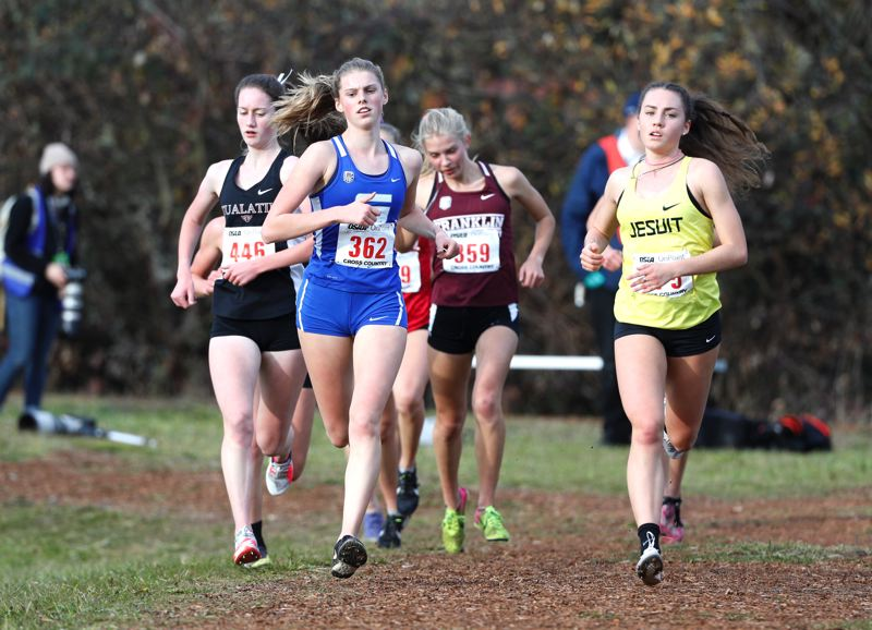 PMG PHOTO: SOOBUM IM - Tualatin High School senior Kaitlyn Gearin (left) races in one of the front packs during Saturday's Class 6A state cross country championships.