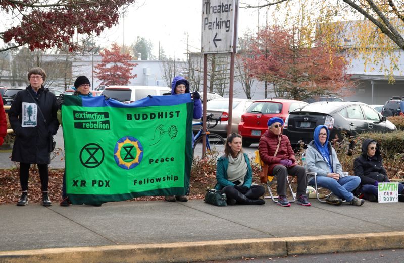 PMG PHOTO: ZANE SPARLING - Protesters with Extinction Rebellion and other groups held a silent prayer vigil outside the David Douglas parking lot before the Oregon Supreme Court arrived.