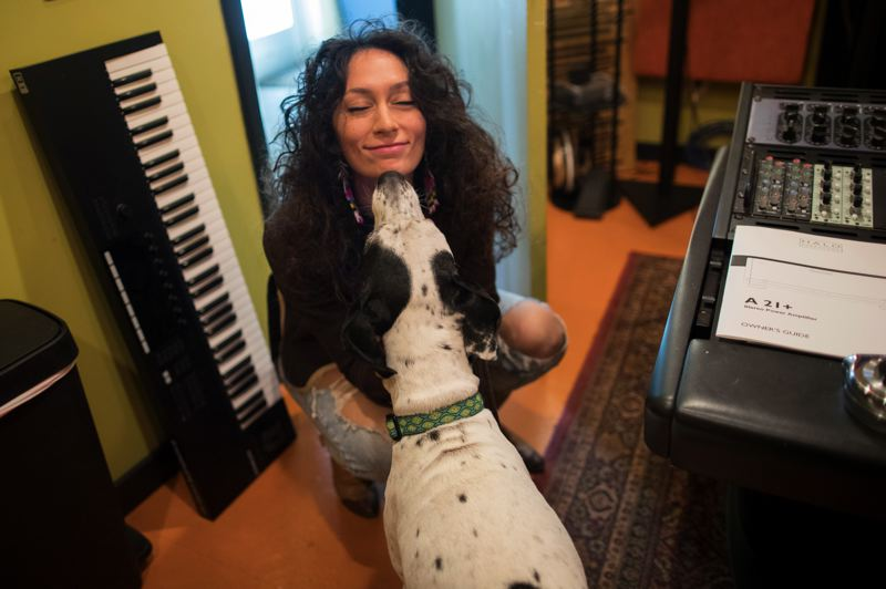 PMG PHOTO: JAIME VALDEZ - The dog at Sonic Media Studios greets Lilla.