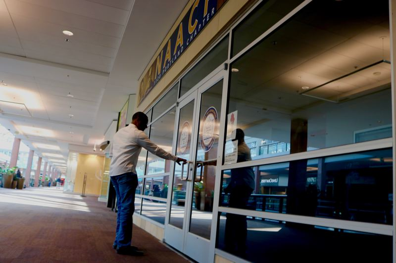 PMG PHOTO: ZANE SPARLING - A member of the public found the doors locked at the Portland branch of the NAACP on the second level of the Lloyd Center mall on Tuesday, Oct. 8.