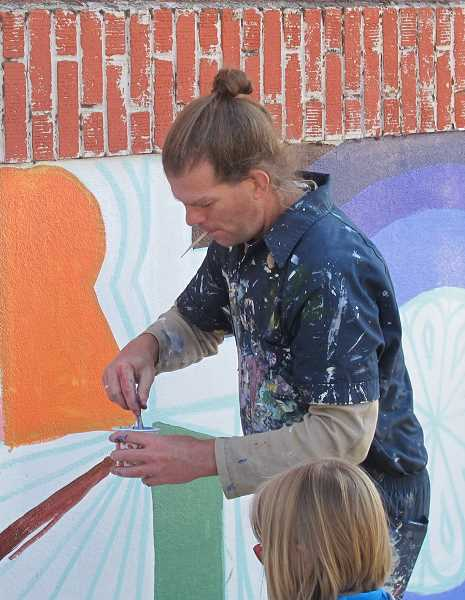Alex Cook, artist, creator, designer and volunteer work crew chief, designed the mural once he saw the space with which he was working.