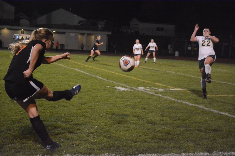 PMG PHOTO: STEVE BRANDON - One of the many highlights for Indian girls soccer this season came when Tessa Davidson (left) connected with Grace Negelspach in the box late in a game at Scappoose High, and Negelspach headed home the winning goal.