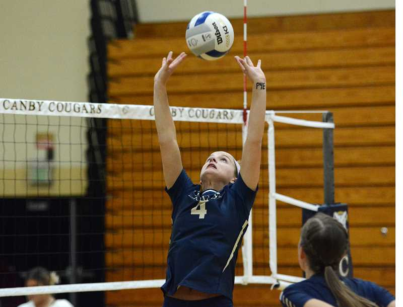 PMG PHOTO: DEREK WILEY - Ruby Kayser sets a ball for the Cougars during her senior season at Canby High School.
