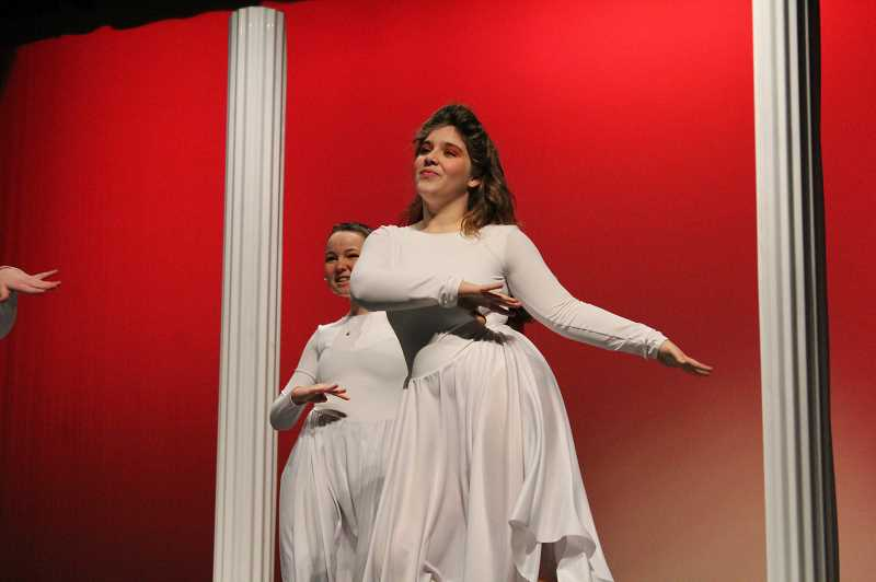 PMG PHOTO: GABBY URENDA - A Forest Grove High School student plays a Greek muse during a musical number in 'Xanadu.' The show is based on the 1980s movie starring Olivia Newton-John and Gene Kelly.