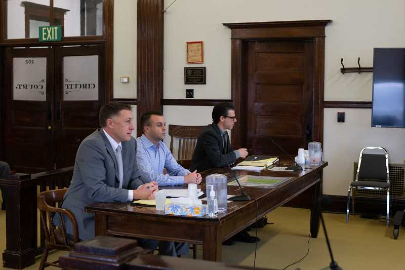 PMG PHOTO: ANNA DEL SAVIO - Attorney Tyler Smith, left, appears with Tyler Miller in court on Tuesday, Nov. 12. Blake Fry, right, represents Columbia 911 Communications District in the legal dispute over the local option levy approved by voters in May.