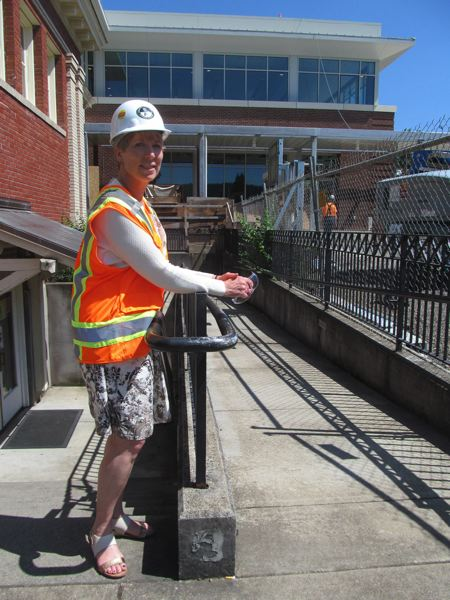 PMG 2016 FILE PHOTO: ELLEN SPITALERI - In this photo from 2016, Maureen Cole, director of the Oregon City Public Library, dons a hart hat in front of the building under construction.