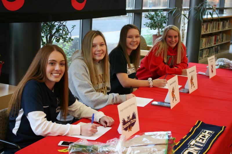 PMG PHOTO: JIM BESEDA - Clackamas student-athletes (left to right) Kiah Wetzell, Madison Rhine, Kathryn Rhine, and Paige Vancil confirmed plans to continue their athletic careers in college during a Nov. 7 signing ceremony in the school library.