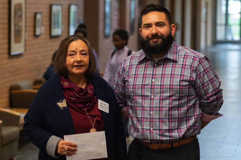 PMG PHOTO: CHRISTOPHER OERTELL - Luz Maciel Villarroel, coordinator of the DREAMers Resource Center at Portland Community College Rock Creek, and her son, Carlos, at a fundraiser for undocumented students on Wednesday, Nov. 13.